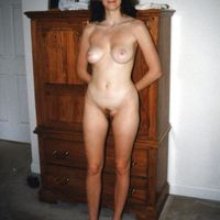 wife poses nude