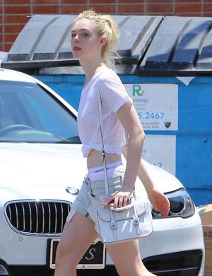 Elle Fanning shows underpants out and..