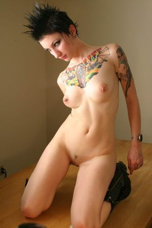 Pierced goth girl revealing all her..
