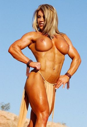 Musclar blonde babe with big clit..