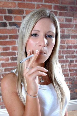 Naughty teen smoker aged 18 smokes a..
