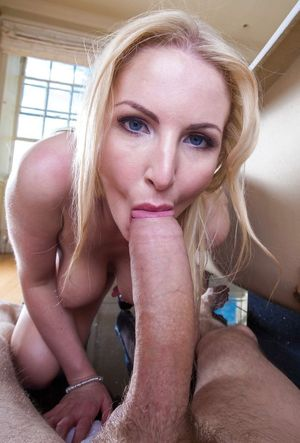Blue Eyed MILF sucking a huge -..