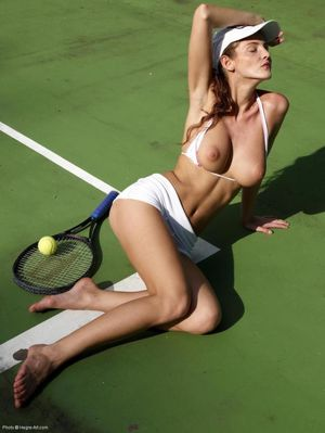 Beautiful girl is playing tennis -..