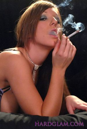 Cate Harrington smokes while she gets..