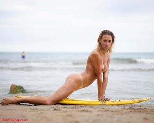 patti-blonde-naked-beach-surfboard-big..