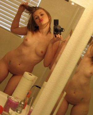 Sexy lusty teen doing duckface selfie..