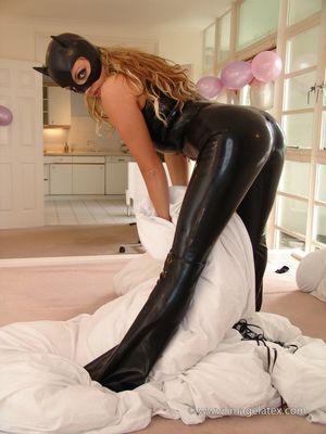 DANNII - Black latex catsuit and latex..
