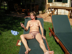 Mature wife sunbathing naked hubby..