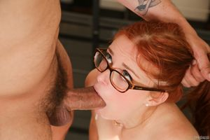 Cute redhead Penny Pax in glasses..