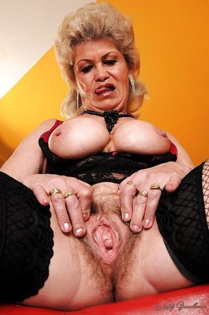 Slutty granny in stockings strips to..
