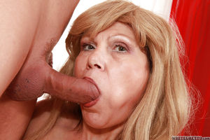 Slutty blonde granny gives a blowjob..