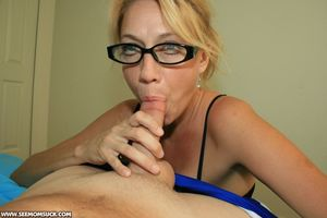 Lusty mature blonde in glasses gives a..