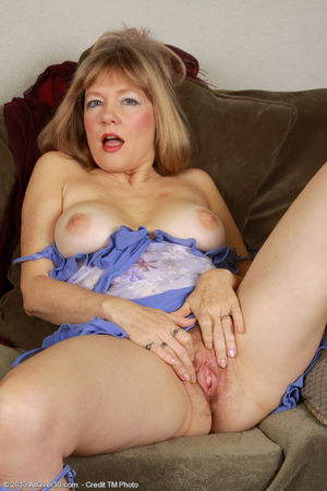 Beautiful mature Lilli fondling her..