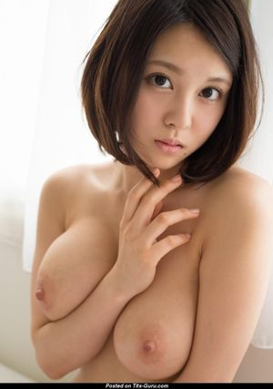 Asian Girl with Bare Natural Ddd Size..