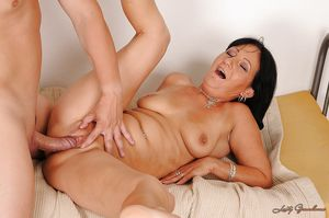 Filthy mature brunette gets a large..