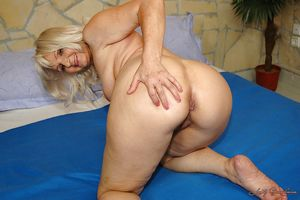 Big titted granny shows her ass..