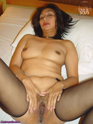 A Filipino wife posing and in action..