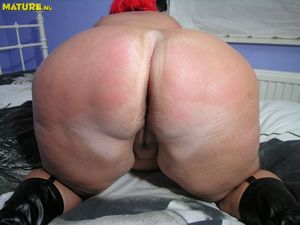 Chubby redhead mature rubs her fat..