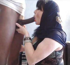 Hijab milf sucks dick and plays with..