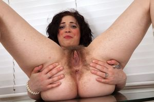 Hairy MILF Bella spreads her bush -..