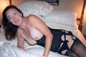 Mature brunette big tits tanlined..