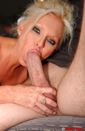 Hot big titted blonde MILF blows cock..