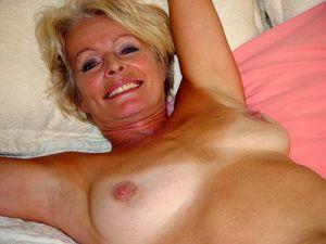Hot blonde mature Justine posing naked..