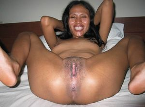 Mature Asian Women Spreading Their..