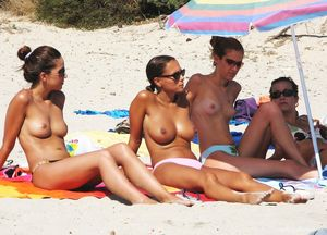 Young girls topless at the beach -..