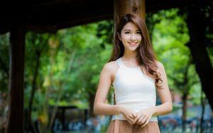 Smiling Asian girl in white T-shirt..