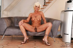 Lusty blonde granny on high heels..