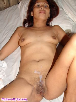 An Asian mom in bedroom action..