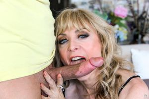 Mature pornstar Nina Hartley awaits an..