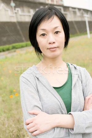 sport mature Asian woman stock photo..