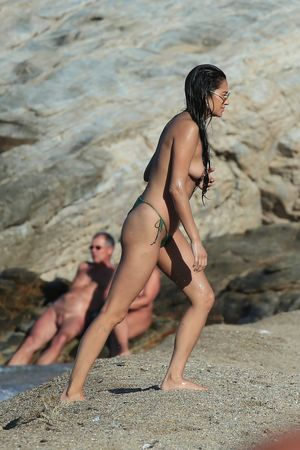 Shay Mitchell topless at a beach in..