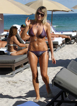 Rita Rusic in Bikini on the Beach..