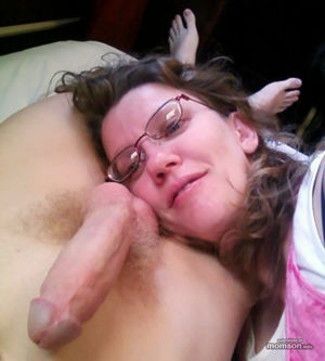 Beautiful mom lying on her real..
