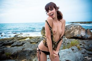 Ariel Rebel flashes by the ocean in..