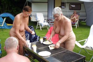 Nudists of different age having..