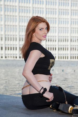 Hot redhead girl Lilith Lust is a sexy..