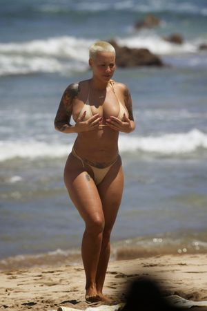Amber Rose Topless Bikini And G-String..