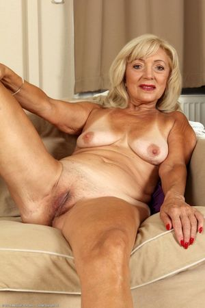 Sexy blonde mature strips naked -..