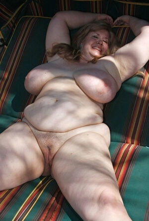 Fat mature naturists posing..