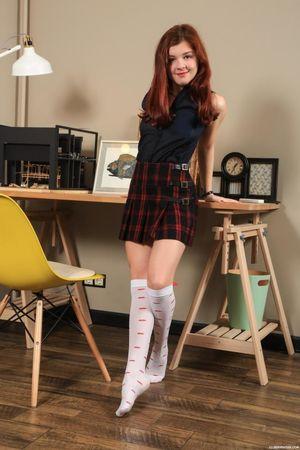 Cute redhead teen schoolgirl..