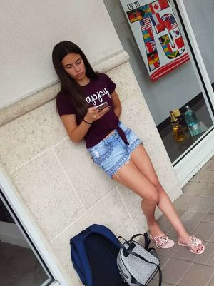 Latina hot legs teen in shorts -..
