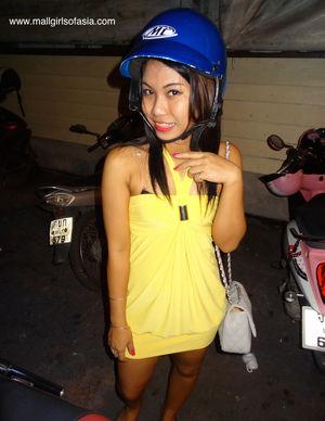 Striking Asian Mall Girls in blue hat..