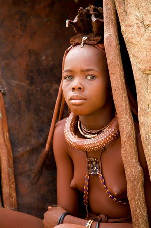 Young himba girls discuss impossible -..