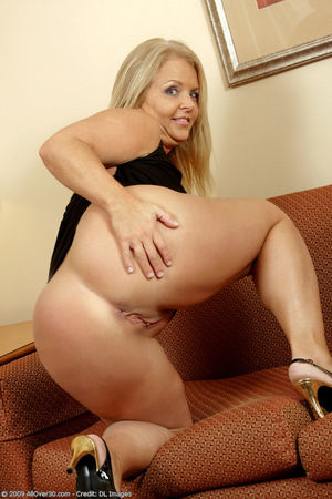 Horny blonde 50 year old playing with..