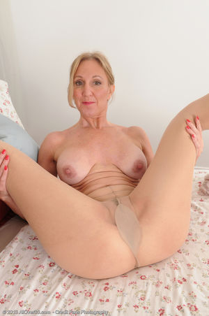 Porn pics of 50 year old blonde hottie..