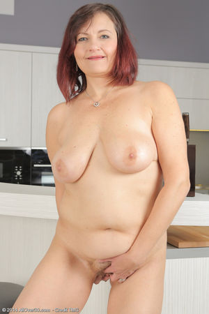 Older woman Justina does a striptease..